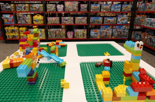 In the children's section at the new and different looking Barnes & Noble at The Village of Rochester Hills there is a LEGO activity table for kids to use and LEGO kits for their parents to buy.The new Barnes & Noble is located in Rochester Hills, Michigan on Tuesday, March 26, 2019.The 14,000 square foot store has a more wide open floor plan with lower profile bookshelves and more area for children's books.