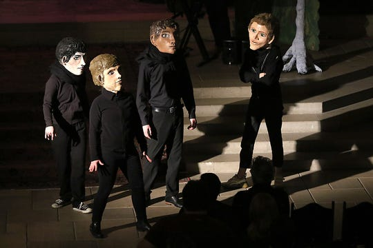 """Malerman stageda theatrical reading from """"Inspection"""" last week in the chapel atDetroit's Masonic Temple. The performers worepapier-mache heads created by hisfiancee, Allison Laakko, to portray the characters."""