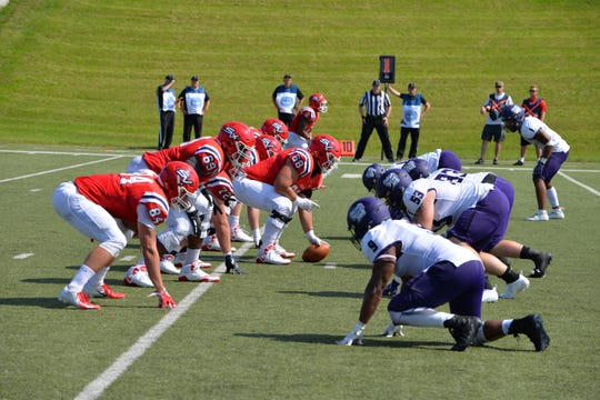 The Saginaw Valley State University football team prepares for a snap during a recent game.