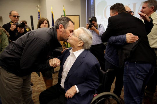 Oakland County Executive L. Brooks Patterson embraces his family, Gary Warner, 44, of Clarkston, after making an announcement that he has Stage 4 pancreatic cancer during a press conference at his office in Waterford, Mich. on Tuesday, March 26, 2019.