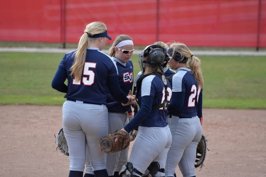 Members of Saginaw Valley State University's softball team gather during a recent game