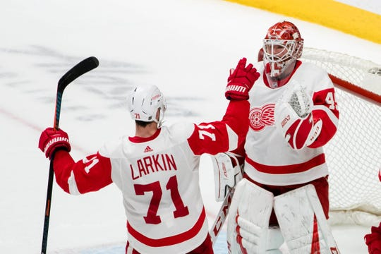 Red Wings center Dylan Larkin and goaltender Jonathan Bernier celebrate their win over the San Jose Sharks at SAP Center at San Jose on March 25, 2019.