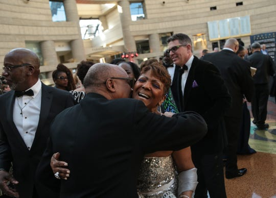 Sabrina Owens, niece of Aretha Franklin, is greeted during the Amazing Grace VIP Pre-Reception at the Charles H. Wright Museum in Detroit on Monday, March 25, 2019. The screening of Aretha Franklin's gospel movie was shown on what would have been Franklin's 77th birthday.