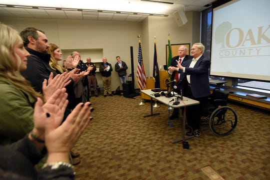 At the conclusion of a press conference, Oakland County Executive L. Brooks Patterson is given a standing ovation.