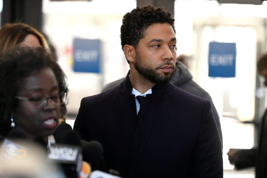 Actor Jussie Smollett looks on during a press conference before leaving Cook County Court after his charges were dropped Tuesday, March 26, 2019, in Chicago.