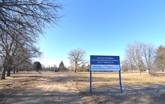 This sign at the site of the proposed new hospital states 'State of Michigan, New State Psychiatric Hospital, MDHHS-Caro Center. Total Project Cost $115,000,000 By The People of The State of Michigan.'