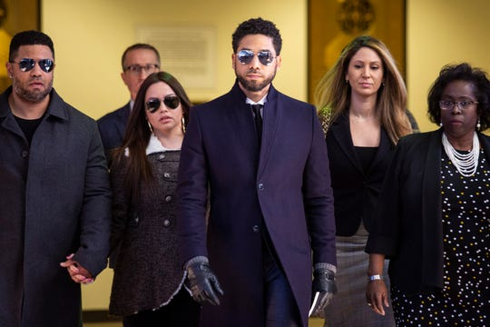 Actor Jussie Smollett, center, leaves the Leighton Criminal Courthouse in Chicago after prosecutors dropped all charges against him on Tuesday, March 26, 2019.