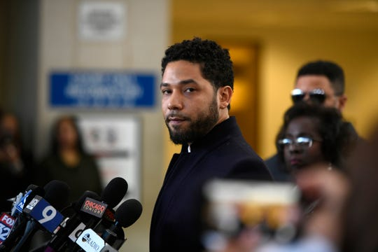 Actor Jussie Smollett talks to the media  after his charges were dropped, Tuesday, March 26, 2019, in Chicago.