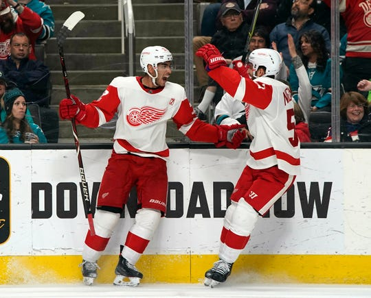 Detroit Red Wings center Andreas Athanasiou (72) celebrates with Frans Nielsen, right, after scoring a goal during the second period.