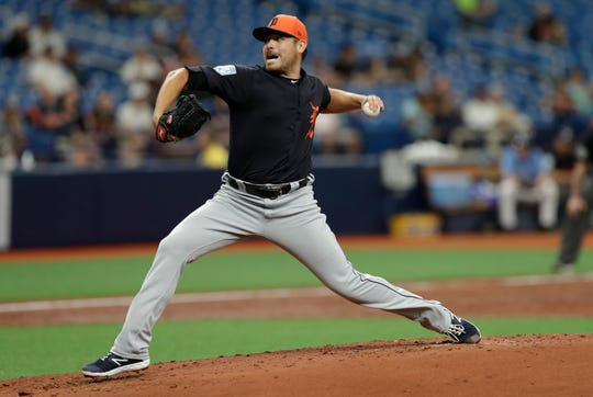 Tigers starting pitcher Matt Moore works against the Rays.