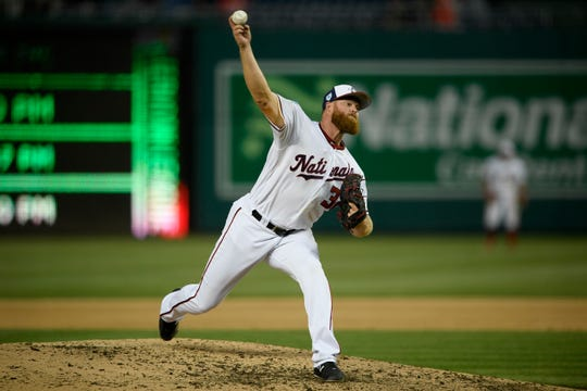 Washington Nationals' Aaron Barrett delivers a pitch during the sixth inning of an exhibition baseball game against the New York Yankees on Monday in Washington.