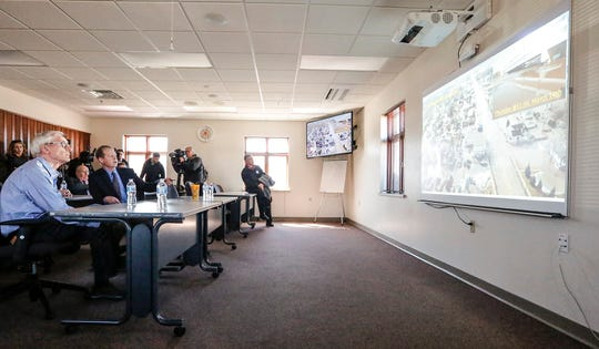 Wisconsin Governor Tony Evers gets briefed on flood damage to the city by Fond du Lac City Manager Joe Moore Tuesday, March 26, 2019 at Fire Station One in Fond du Lac.