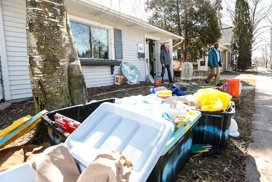 Wisconsin Governor Tony Evers exits a house Tuesday, March 26, 2019 in Fond du Lac, that sustained severe damage when Fond du Lac was hit with flooding March 14, after the Fond du Lac River flowed over it's banks due to ice jams, heavy rain and snow melt.