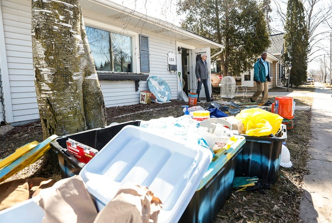 Wisconsin Governor Tony Evers exits a home on Lincoln Avenue, Tuesday, March 26, 2019 in Fond du Lac, which received a notice from the city after being significantly damaged by flooding March 14 when the Fond du Lac River flowed over it's banks due to ice jams, heavy rain and snow melt.