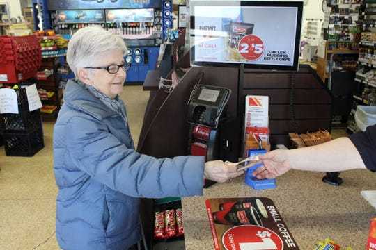 Nancy Conn buys a Powerball ticket she hopes will win her $750 million.