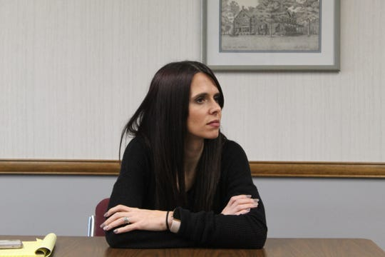 Kelly Beeker, a supervisor at Sandusky County Department of Job and Family Services, discusses fears she's experienced while visiting homes during a recent round table discussion of social workers.