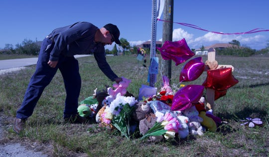 Josh Jasilewicz, a lineman for an electric company, came to pay his respects Tuesday afternoon and delivered a teddy bear to the memorial site for Layla Aiken visible on the corner of NE 3rd Avenue and NE 19th Terrace in Cape Coral.  Layla Aiken was killed while waiting for her school bus Monday morning.