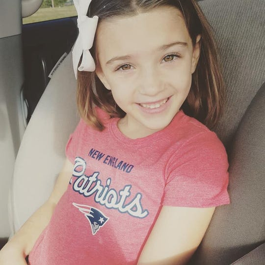 Layla Aiken, 8, was killed in a hit-and-run while waiting at her school bus stop.