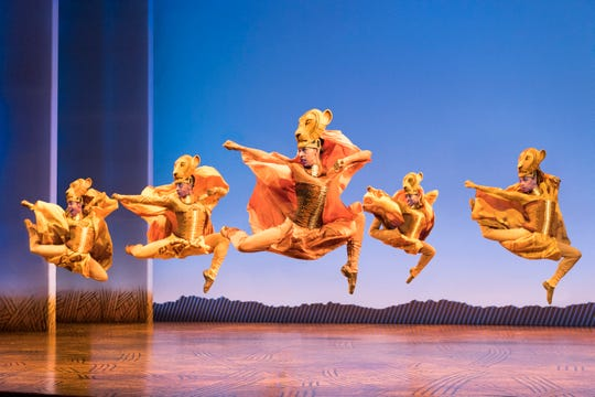 "The lionesses dance in a scene from the national tour of ""The Lion King."""