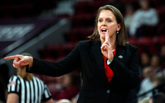 South Dakota head coach Dawn Plitzuweit calls out a play to her team during the second half of a first round women's college basketball game against Clemens in the NCAA Tournament in Starkville, Miss., Friday, March 22, 2019. (AP Photo/Rogelio V. Solis)