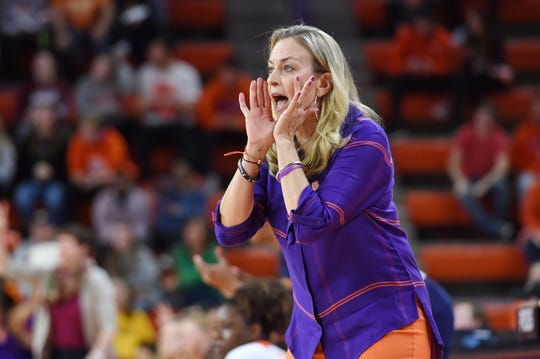 FILE - In this Jan. 31, 2019, file photo, Clemson head coach Amanda Butler reacts during the first half of an NCAA college basketball game against Notre Dame, in Clemson, S.C. Clemson is 18-11 after 13 straight losing seasons. The Tigers have gone 9-7 in ACC games after winning a total of nine ACC games the previous five years. It's happened with first-year coach Amanda Butler, who took a season off after spending 10 years at Florida as head coach. Clemson is projected to make the NCAA Tournament for the first time since 2002. (AP Photo/Richard Shiro, File)
