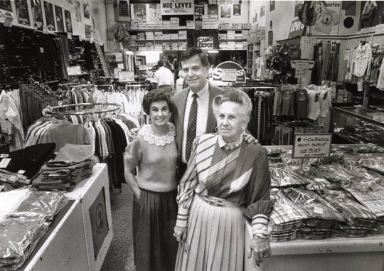Gloria Rittenberg, her husband Harold Rittenberg, and Florence Levy stand amid jeans and tops stacked in their Moe Levy's Assembly Street store in 1987.