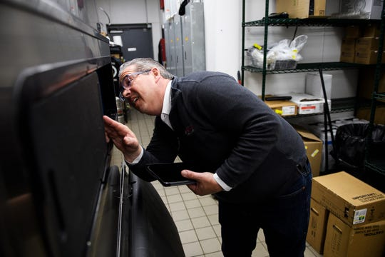 Bob Munnich checks out the ice machine as he performs a  sanitation inspection at Grill Marks' Haywood Mall location Monday, March 25, 2019.