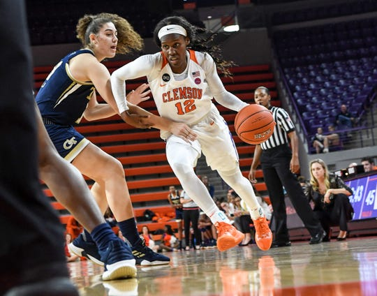 Clemson guard Aliyah Collier(12) dribbles near Georgia Tech guard Frescesca Pan(33) during the fourth quarter at Littlejohn Coliseum in Clemson Thursday, January 17, 2019.