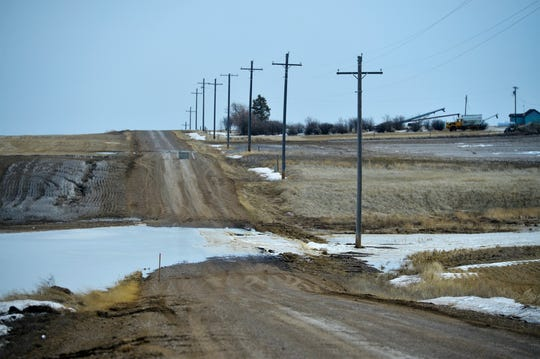 Spring snowmelt runs over East Portage Road north of Great Falls on Tuesday.  Minor flooding has caused road closures on numerous roads in Cascade and Chouteau Counties.