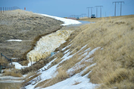 Snowmelt runs into a culvert below Highway 87 north of Great Falls on Tuesday afternoon.