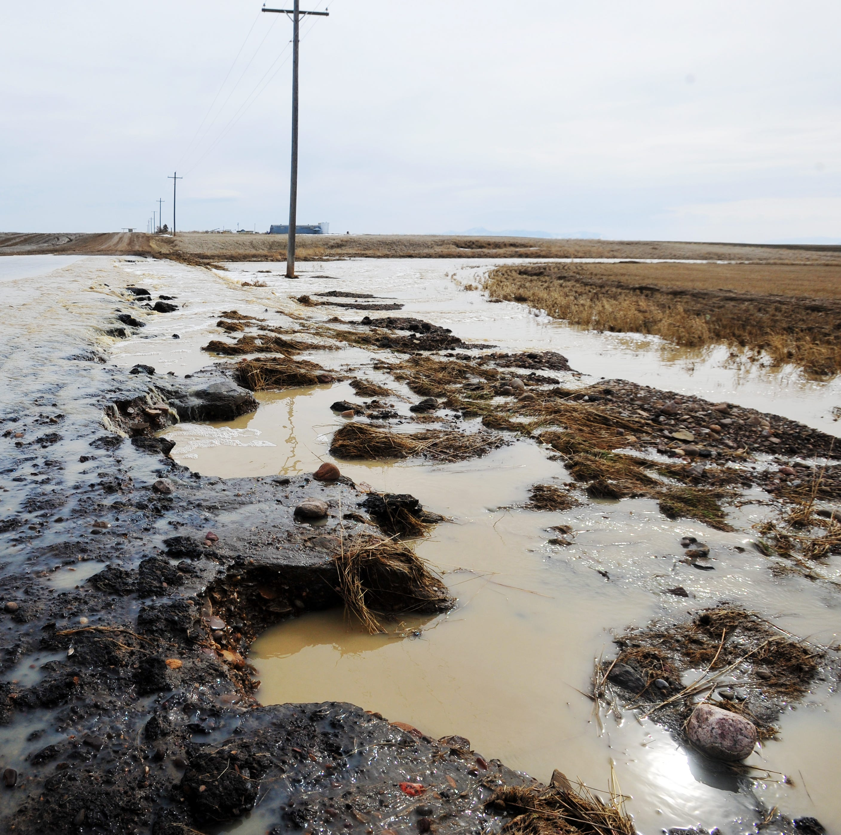 Snowmelt tsunami flows over rural roads, fields