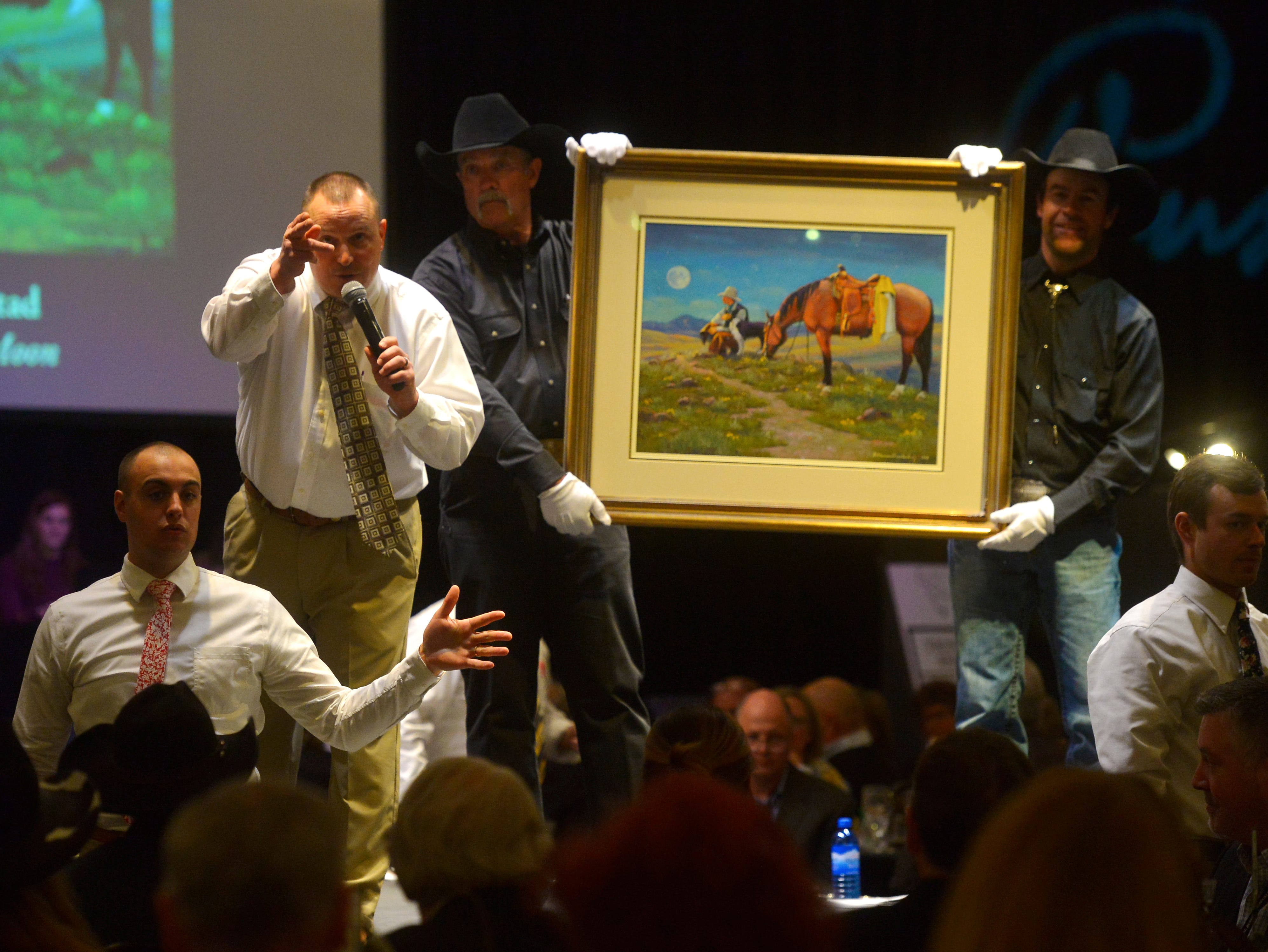 "H. Steven Oiestad's ""Once in a Blue Moon"" at The Russell Live Auction on Saturday night in the Great Falls Civic Auditorium."