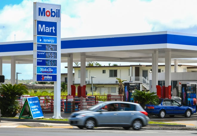 Signage in front of the Mobil Mart gas station in Sinajana reflects an increase of ten cents for the price of fuel on Tuesday, March 26, 2019.