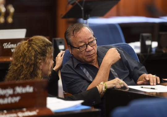 "Sen. Joe ""Pedo"" Terlaje has a discussion with Sen. Kelly Marsh during a session recess at the Guam Congress Building, March 26, 2019."