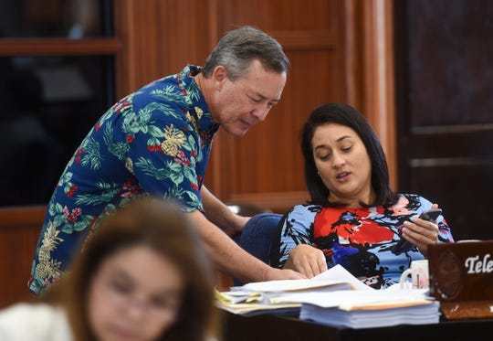 Sens. James C. Moylan and Telena Nelson during a session recess at the Guam Congress Building, March 26, 2019.