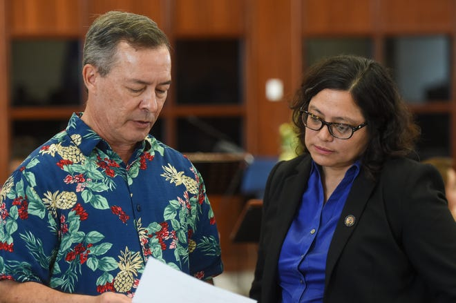Sens. James C. Moylan and Sabina Perez during a session recess at the Guam Congress Building, March 26, 2019.