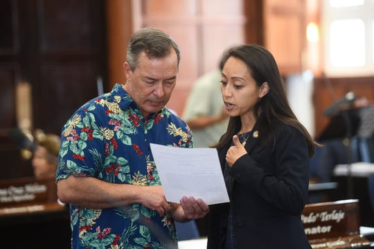 Sens. James C. Moylan and Regine Biscoe Lee during a session recess at the Guam Congress Building in Hagåtña, March 26, 2019.