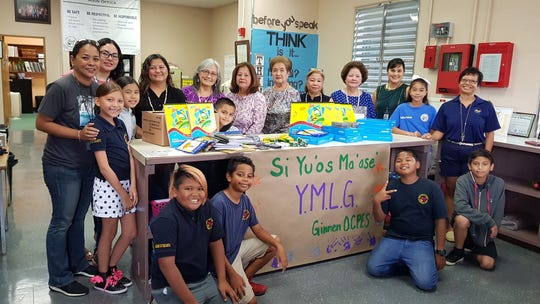The Young Mens' League of Guam Ladies Auxiliary donated school supplies for the students of Chamorro Studies Program at Ordot Chalan Pago Elementary School on March 11. This is a project of the organization during  Guam History and Chamorro Heritage Day, an annual Government of Guam holiday. OCPES is the eleventh Guam Public School that the YMLG Ladies Auxiliary has made donations to during the month of March. Pictured in front from left: Terence Leon Guerrero, George Gilchon, Devin Reyes, and Hugo Reyes. Back row, left: Toria Arceo, CHamoru teachers Sheila Paulino and Chriselle Muna, student Zoiejean Techaira, YMLG Ladies Auxiliary Lori Toves and Lou Benavente, student Jesse Meno, YMLG Ladies Auxiliary Lucy Martinez, vice president Sue Carbullido, secretary Rose Pelkey and Pat Muna, OCPES Principal Tricia Moylan, student Heaven Quichocho, and CHamoru teacher Rosie Howser.