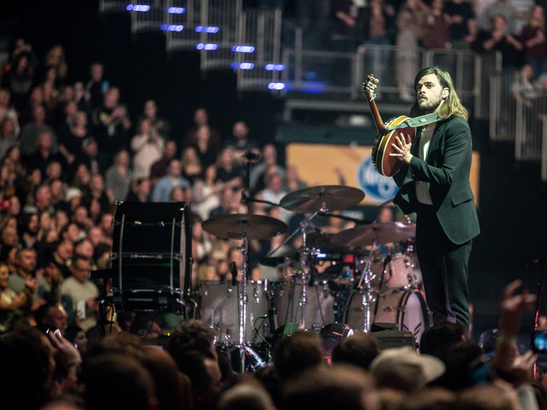 Winston Marshall, with the British band Mumford & Sons plays banjo with the band at Bankers Life Fieldhouse in Indianapolis on Monday, March 25, 2019.