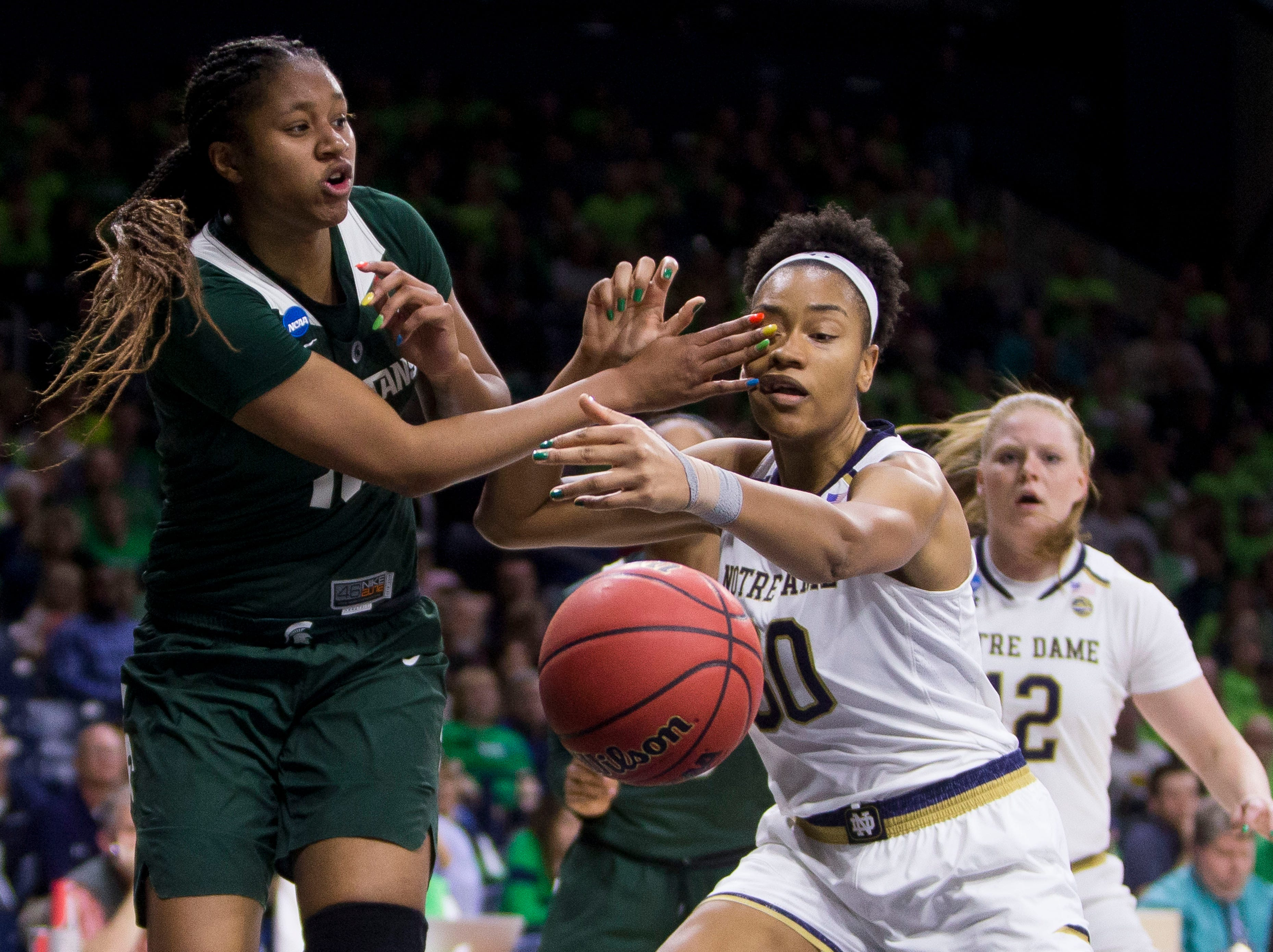 Michigan State's Sidney Cooks (10) hits Notre Dame's Mikayla Vaughn (30) while competing for a rebound during a second-round game in the NCAA women's college basketball tournament in South Bend, Ind., Monday, March 25, 2019. (AP Photo/Robert Franklin)