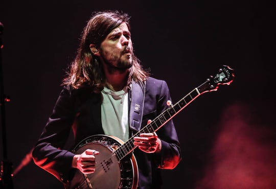 Winston Marshall performs with Mumford & Sons Monday at Bankers Life Fieldhouse.