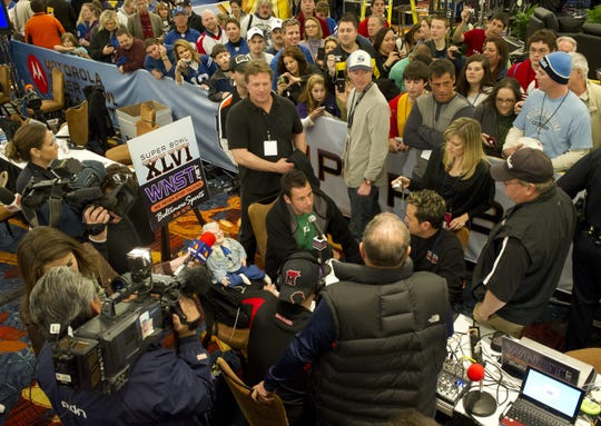 Journalists and fans swarm as Adam Sandler gives interviews at Radio Row in the JW Marriott during the Superbowl XLVI Festivities in Indianapolis on Feb. 3, 2012.