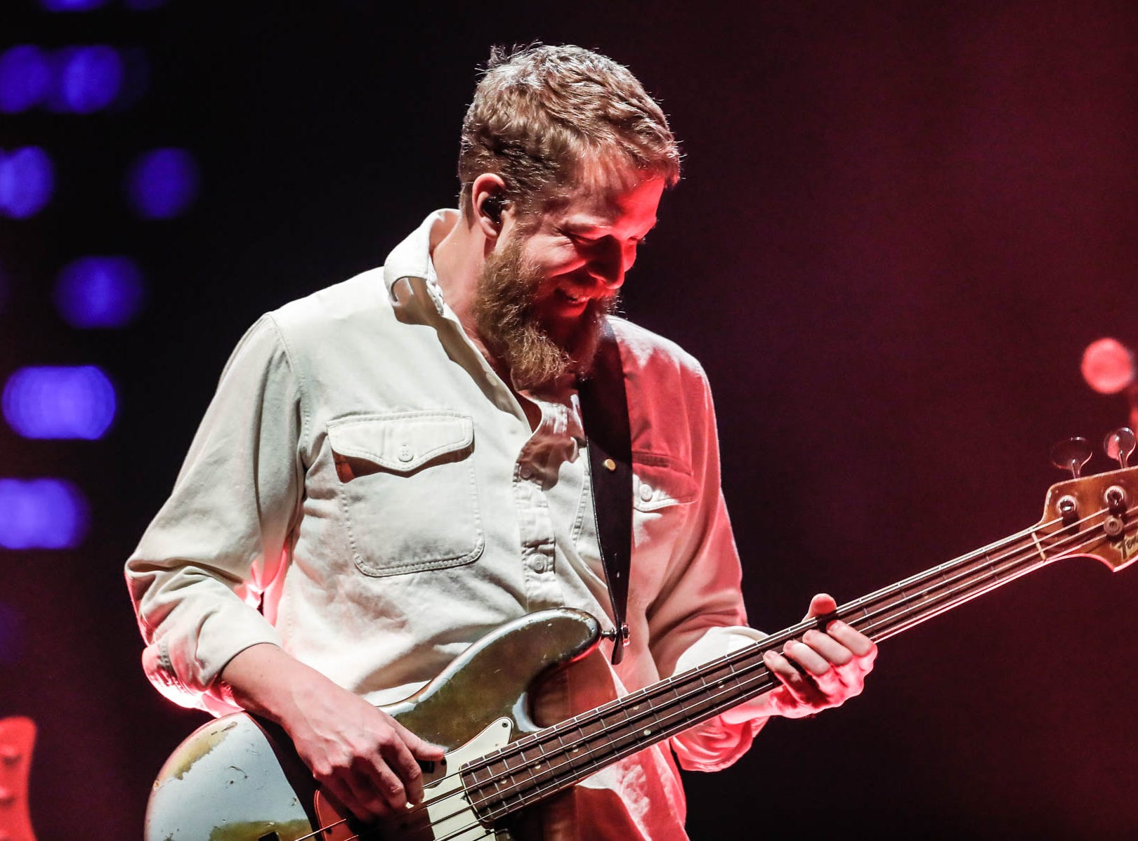 Ted Dwane, bass player for the British band Mumford & Sons rocks out with the band at Bankers Life Fieldhouse in Indianapolis on Monday, March 25, 2019.