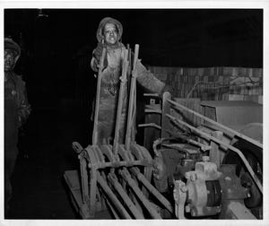 Wrench operator at the blast furnace at U.S. Steel in 1943.