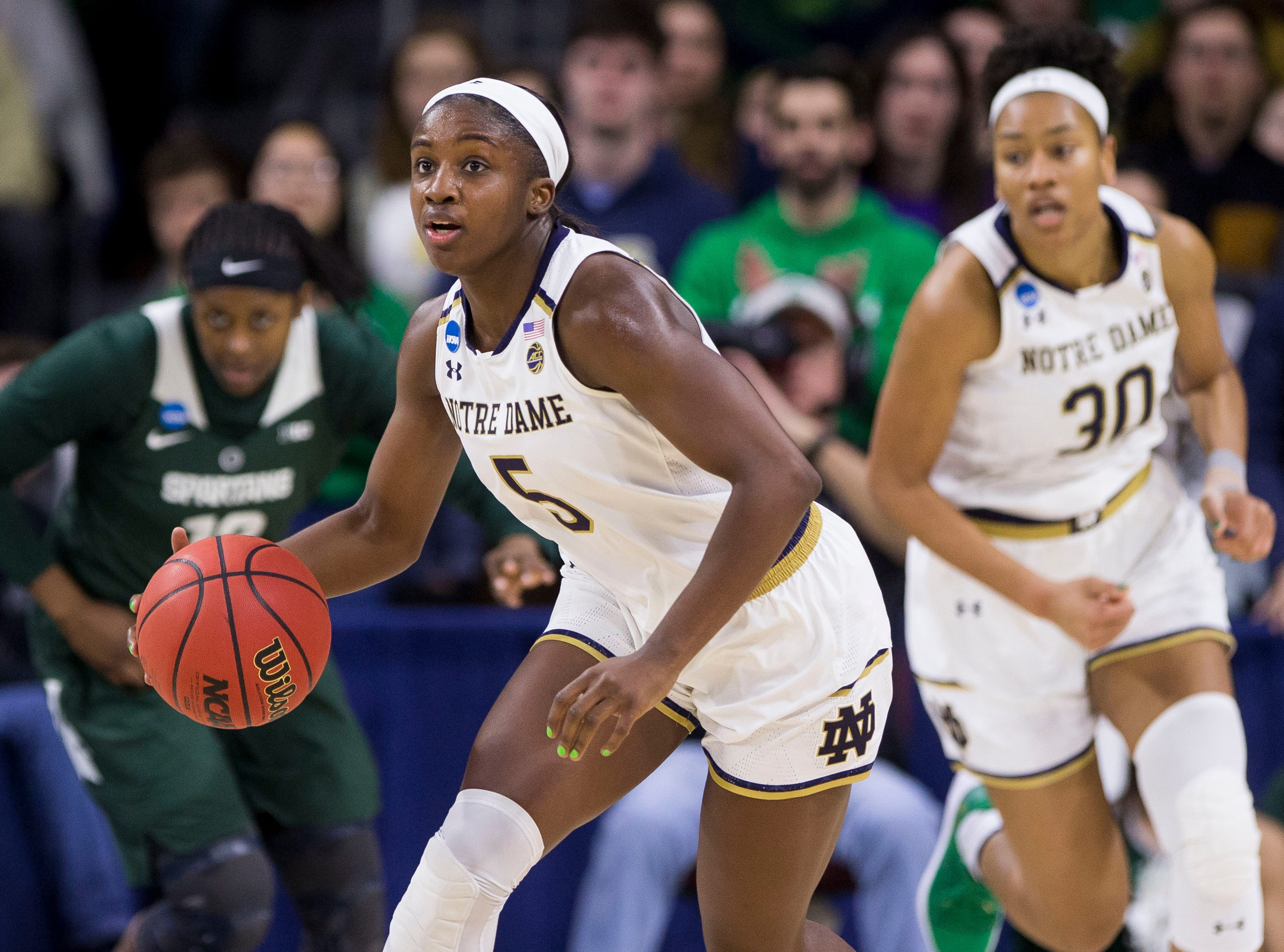 Notre Dame's Jackie Young (5) drives downcourt during a second-round game against Michigan State in the NCAA women's college basketball tournament in South Bend, Ind., Monday, March 25, 2019. (AP Photo/Robert Franklin)