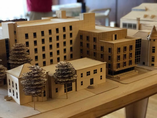 A wooden model of Block 20 sits inside the Athenaeum to show how the  two buildings would complement one another.
