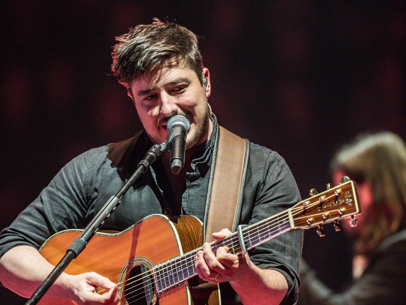 Marcus Mumford, lead vocalist for the British band Mumford & Sons performs with the band at Bankers Life Fieldhouse in Indianapolis on Monday, March 25, 2019.