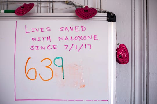 A whiteboard displays a running count of the 639 lives saved with Naloxone distributed by the Iowa Harm Reduction Coalition since July 1, 2017, on Monday, March 18, 2019, inside their office at 1216 2nd Ave. SE in Cedar Rapids, Iowa.