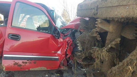 A woman was extricated from her vehicle and airlifted to a hospital following crashes involving a manure spreader.