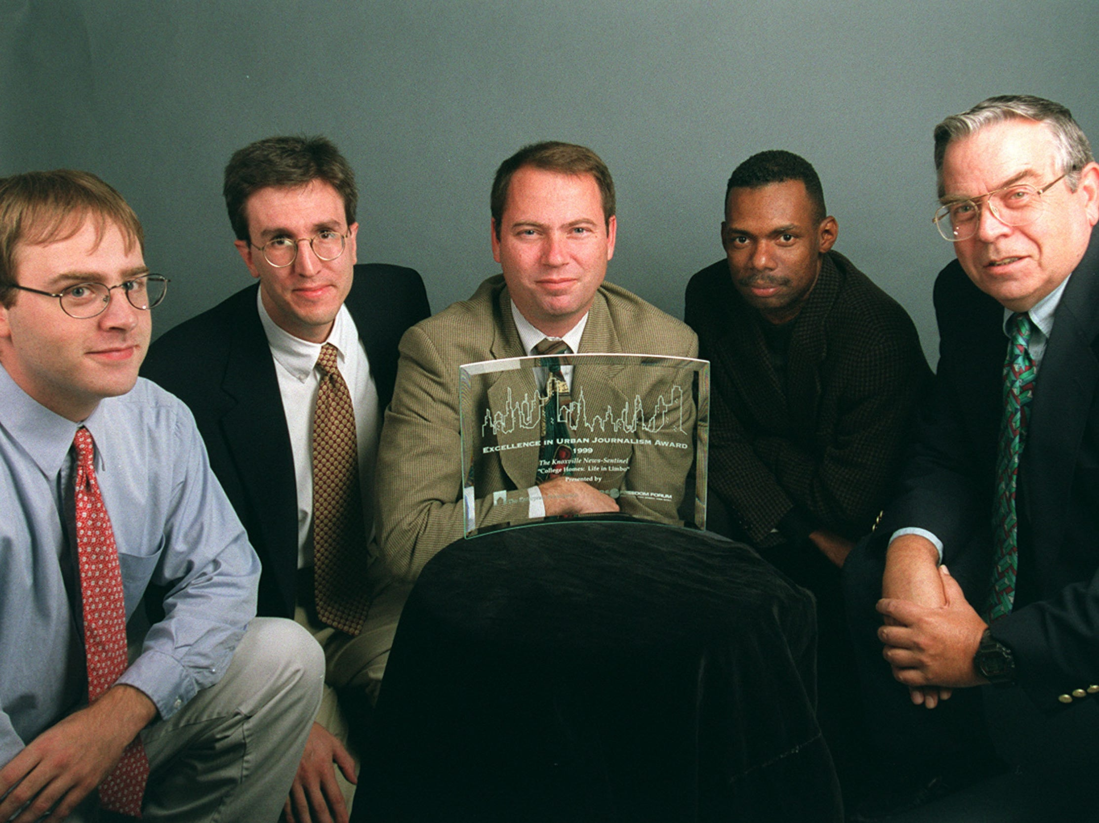 """Knoxville News-Sentinel reporter Jacques Billeaud, left, reporter David Keim, photographer Paul Efird, reporter Add Seymour and copy editor Gerry Segroves are shown on Oct. 22, 1999, after winning the 1999 Excellence in Journalism Award for their collaboration on """"College Homes: Life in Limbo,"""" an eight-page section published April 12, 1998. Given by The Enterprise Foundation and The Freedom Forum, the Excellence in Urban Journalism Award recognizes quality reporting on issues facing the nation's urban areas."""